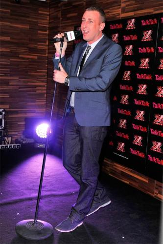 Christopher Maloney performs at the TalkTalk X Factor gig