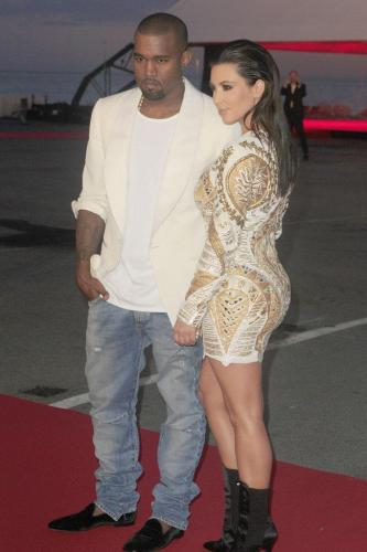 Kim Kardashian is trying to impress Kanye West
