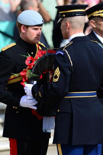 Prince Harry about to lay a wreath on JFK's grave