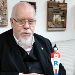 Artist Sir Peter Blake holding the BRIT Awards 2012 trophy