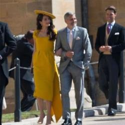 Amal and George Clooney attend royal wedding