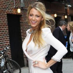 Blake Lively wears a blush-coloured cocktail dress