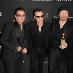 Larry Mullen Jr. with U2 bandmates Bono and The Edge