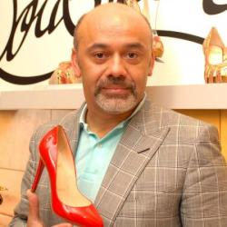 Christian Louboutin and a pair of his stunning shoes