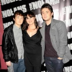 Coleen Nolan with sons Jake (left) and Shane (right)