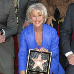 Helen Mirren wears a beautiful blue Escada dress and coat to get her star