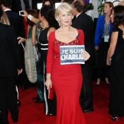 Dame Helen Mirren shows a 'Je Suis Charlie' signage at the Golden Globes