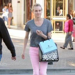 Diane Kruger keeps the look simple with a grey marl tee