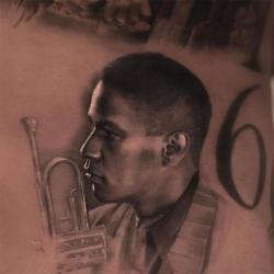 Drake gets new tattoo of Denzel Washington