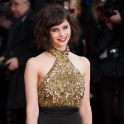 Felicity Jones looks chic in Alexander McQueen