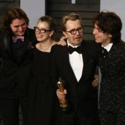 Gary Oldman with his sons and wife Gisele