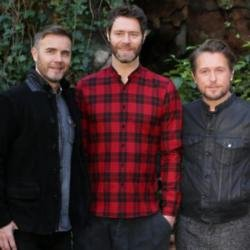 Howard (centre) with Gary Barlow (left) and Mark Owen (right) (c) Twitter