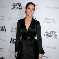 Jennifer Lawrence opts for an edgy black dress/coat by Dior