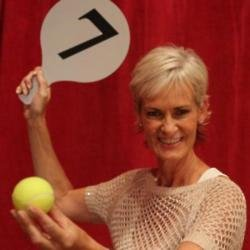 Judy Murray holding score panel