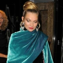 Kate Moss keeps it covered in a polo neck