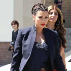 Kim Kardashian looks smart in navy