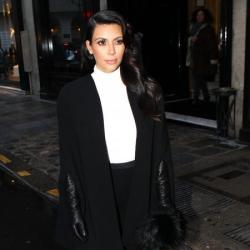 Kim Kardashian looks chic in her black trousers