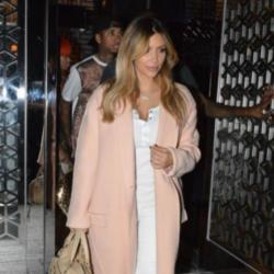 Kim Kardashian steps out in the must have pink coat