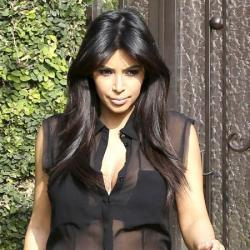 Kim Kardashian steps out in a sheer blouse
