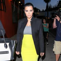 Kim Kardashian looks sleek in yellow