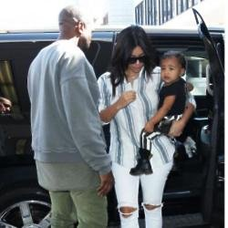 Kim Kardashian West, Kanye West and North West at LAX