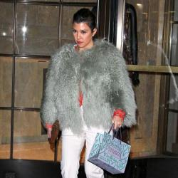 Kourtney Kardashian wears the white trousers