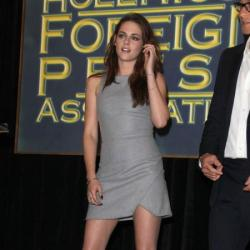 Kristen looks beautiful in a Bec & Bridge grey dress