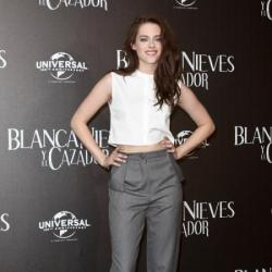 Kristen Stewart dresses up her pants with heels