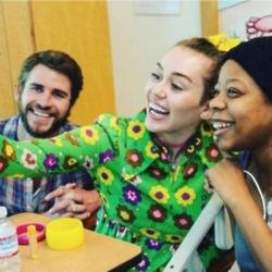 Liam Hemsworth, Miley Cyrus, and a fan via Instagram