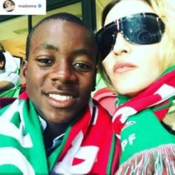 Madonna and David at the Portugal match (c) Madonna/Instagram