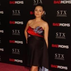 Mila Kunis' daughter drinks wine