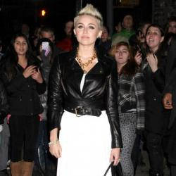 Miley Cyrus steps out in a cropped jacket