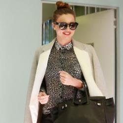 Miranda Kerr pairs her leather trousers with a printed blouse