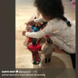 North West and her Kanye doll (c) Twitter