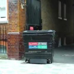 Man moves into recycling bin