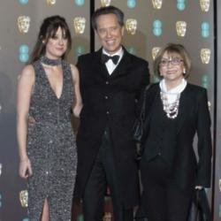 Richard E. Grant with his daughter and wife