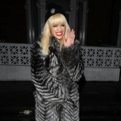 Rita Ora keeps warm in her coat