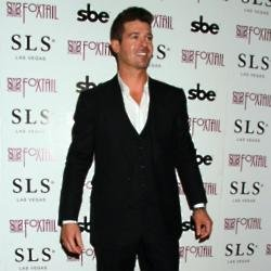 Robin Thicke takes legal action against dad Alan's widow over estate