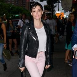 Rose McGowan hands herself in to police