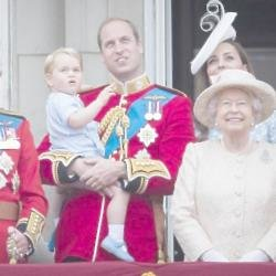 Prince William holding his son Prince George, with Queen Elizabeth