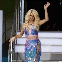 Shane Jenek as Courtney Act