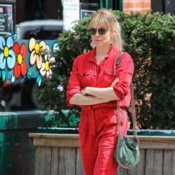 Sienna Miller works the boiler suit look