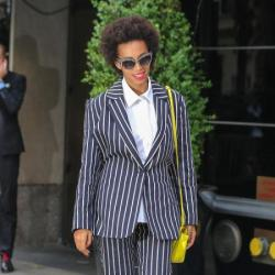Solange Knowles pairs a colour pop bag with her suit