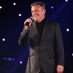 Suggs on stage at An Evening with Suggs