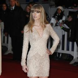 Taylor Swift looks hot in embellised Elie Saab mini