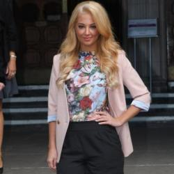 Tulisa outside court today sporting her new blonde 'do