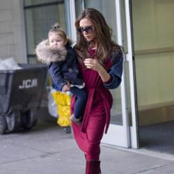 Victoria Beckham and Harper arriving in New York