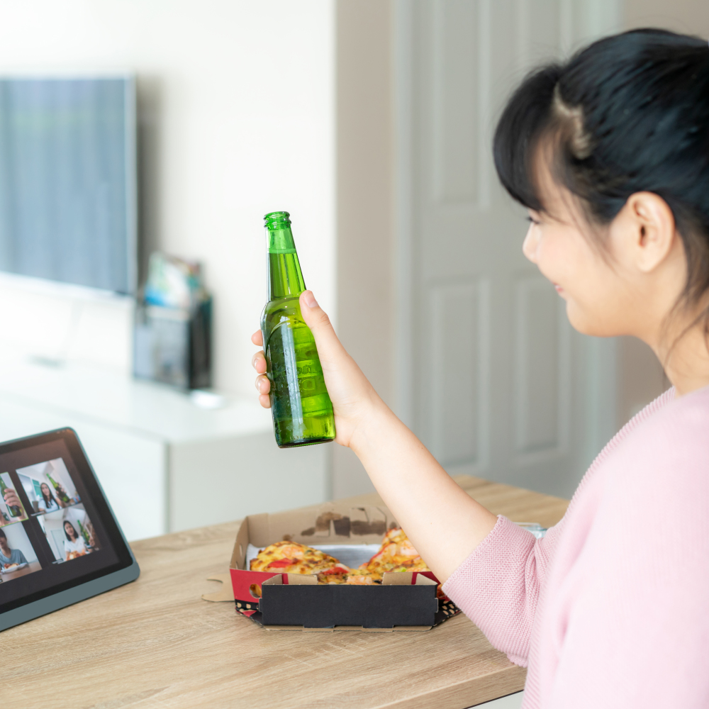 A woman takes part in 'virtual drinks' with friends