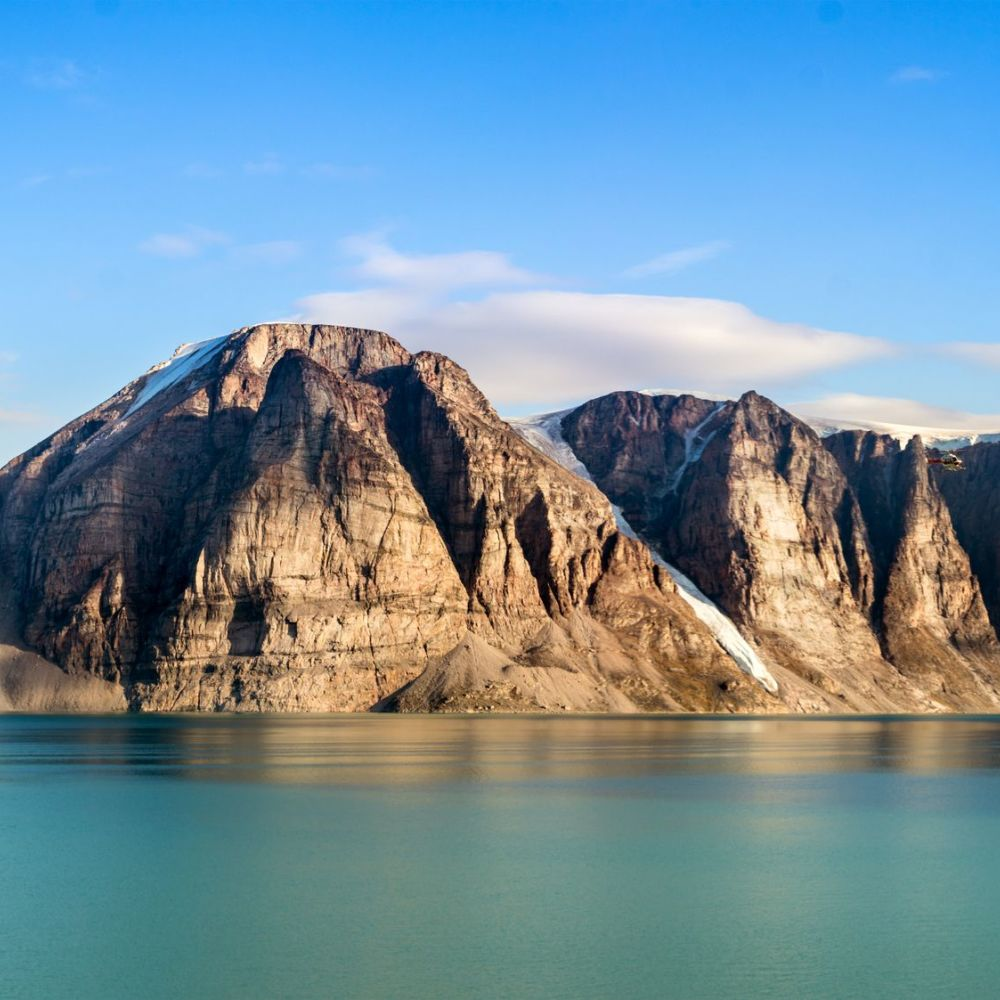 Panoramic view of the cliffs and mountains in Buchan Gulf, Baffin Island, Canada (iStock/PA)