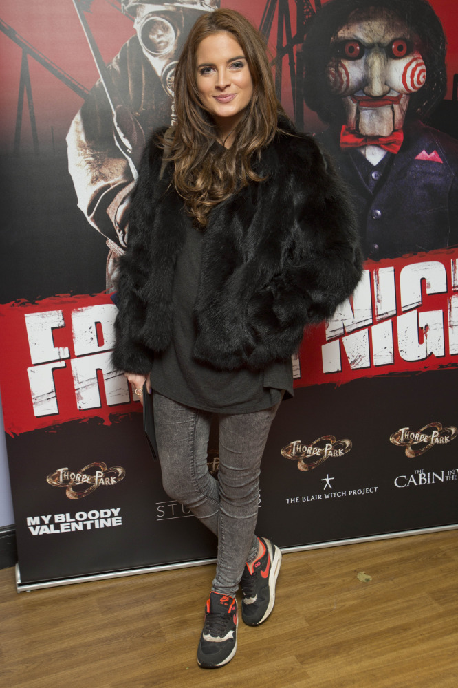 Binky Felstead adds glamour to her look with a faux fur jacket